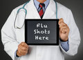 Doctor Tablet Computer Flu Shots Royalty Free Stock Photo