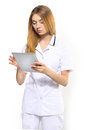 Doctor with tablet young doctors on a white background Royalty Free Stock Photography