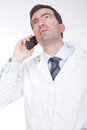 Doctor talking on the phone and looking worried Royalty Free Stock Photo