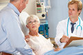 Doctor Talking To Senior Couple On Ward Royalty Free Stock Image
