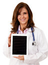 Doctor using a tablet computer Stock Photo