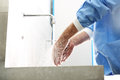 The doctor washes his hands disinfect their before surgery Royalty Free Stock Image