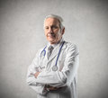 Doctor wearing a white coat Stock Photo