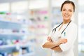 Doctor woman in drug store young positive brunette Royalty Free Stock Photos