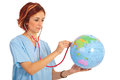 Doctor woman examine world globe isolated on white background Stock Photo