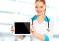 Doctor woman holding a blank white tablet computer empty Royalty Free Stock Photo