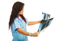 Doctor woman looking on xrays Royalty Free Stock Photo
