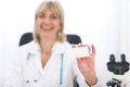Doctor woman showing business card Royalty Free Stock Photos