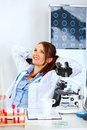 Doctor woman sitting at office table and relaxing Royalty Free Stock Photography