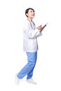 Doctor woman using pc in full length Royalty Free Stock Images