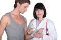Doctor wrapping gauze around wrist a patient s Royalty Free Stock Photo