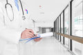 Doctor writing a medical prescription at new empty hospital hall Royalty Free Stock Photo