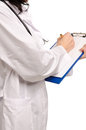 Doctor writing notes on a clipboard Royalty Free Stock Photos