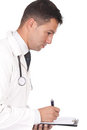Doctor writing notes and prescriptions Royalty Free Stock Image