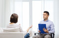 Doctor and young woman meeting at home visit medicine health care people concept with clipboard women Royalty Free Stock Photography
