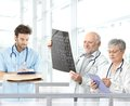 Doctors discussing diagnosis in hospital lobby Royalty Free Stock Photography