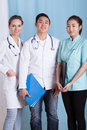 Doctors and female assistant before work vertical Stock Photo