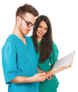 Doctors with a folder young male and female nurses student interns Stock Images