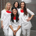 Doctors four modern female in wearing white uniforms Royalty Free Stock Images