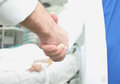 Doctors handshake concept of cooperation in patient treatment Royalty Free Stock Photo