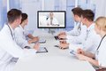 Doctors having video conference meeting in hospital Royalty Free Stock Photo