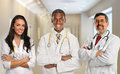 Doctors in hospital building group of three diverse with arms crossed inside Royalty Free Stock Photography