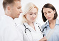 Doctors looking at tablet pc healthcare and technology concept Royalty Free Stock Photography