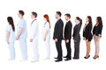 Doctors and managers standing in queue isolated on white Stock Photo