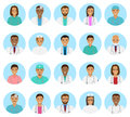 Doctors and nurses characters avatars set. Medical people icons of faces on a blue background. Royalty Free Stock Photo