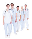 Doctors and nurses standing in a row happy group of over white background Royalty Free Stock Photos