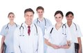 Doctors and nurses with stethoscope happy group of standing over white background Stock Photos