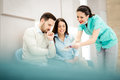 Doctors and patients speaking in the hospital waiting room Royalty Free Stock Photo