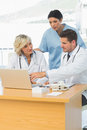 Doctors using laptop together at the medical office Royalty Free Stock Images
