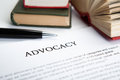 Document with the title of advocacy closeup Stock Photo