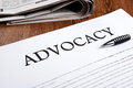 Document with the title of advocacy closeup Royalty Free Stock Photo