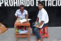 Document typist a man types up documents on the streets in peru Royalty Free Stock Photography