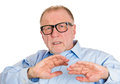 Dodge closeup portrait senior mature man in black glasses looking scared trying to protect himself from unpleasant situation Stock Images