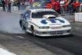Dodge drag car nhra national open july – front side view of making a smoke show on the track Stock Image