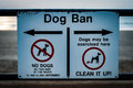 Dog ban sign small steel giving information about a on a public beach Royalty Free Stock Photos