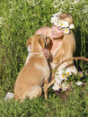 Dog and blond woman with her in nature Royalty Free Stock Images