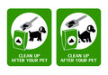 Dog clean up signs two instructing owners to after their pet Royalty Free Stock Images