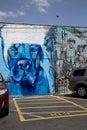 Dog graffiti on  brick  wall of parking lot Royalty Free Stock Photo