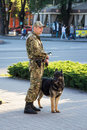 Dog handler guarding public safety Royalty Free Stock Photo