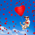 Dog hanging on balloon in  air for valentines day Royalty Free Stock Photo