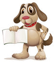 A dog holding an empty book Royalty Free Stock Photo