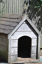 Dog house an empty wooden for a built in the backyard of a family Stock Images