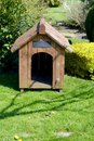 Dog kennel a empty in a home garden Stock Images
