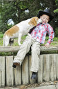 Dog kiss boy gets a from his Royalty Free Stock Photo