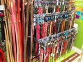 Dog leads leashes and collars a rack in a pet shop containing Royalty Free Stock Photography