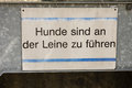Dog on leash sign in german Royalty Free Stock Photo
